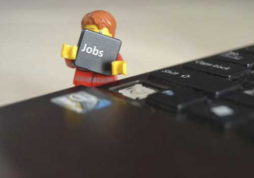 Lego man Holding a job key from a keyboard
